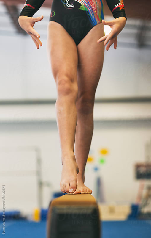 Gymnastics: Girl Points Toe And Has Pretty Hands During Routine by Sean Locke for Stocksy United