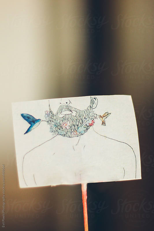 Illustration on a small piece of paper  by Evil Pixels Photography for Stocksy United