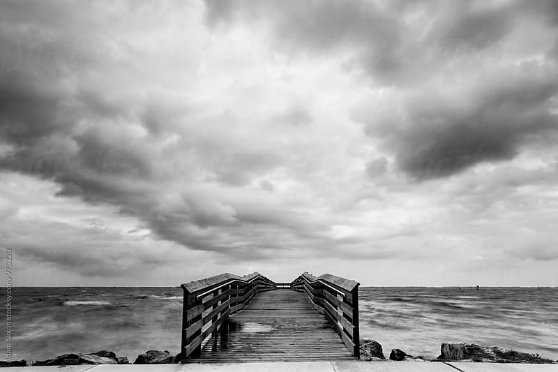 Wooden fishing pier in a storm by Adam Nixon for Stocksy United