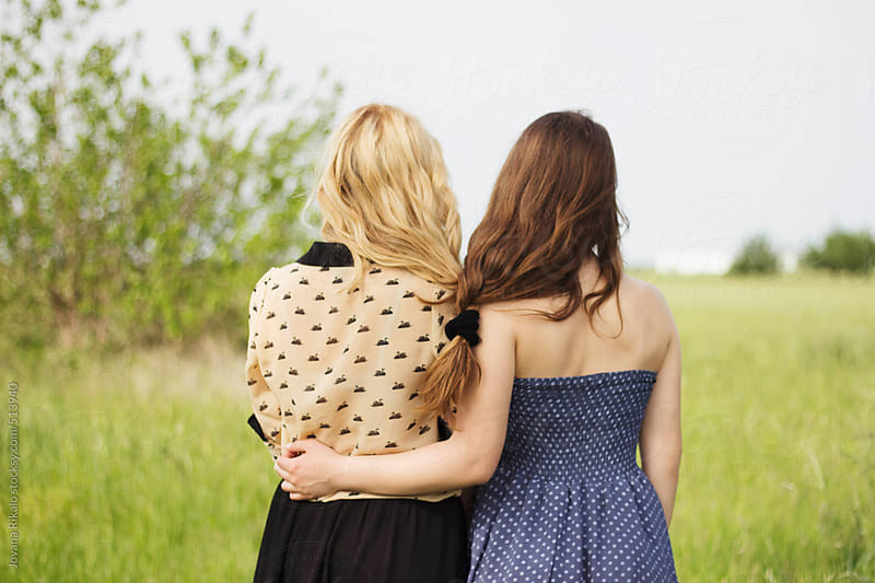 Back view of a two female friends hugging by Jovana Rikalo for Stocksy United