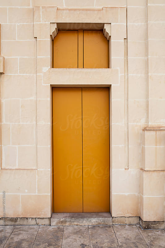 Yellow door by MEM Studio for Stocksy United