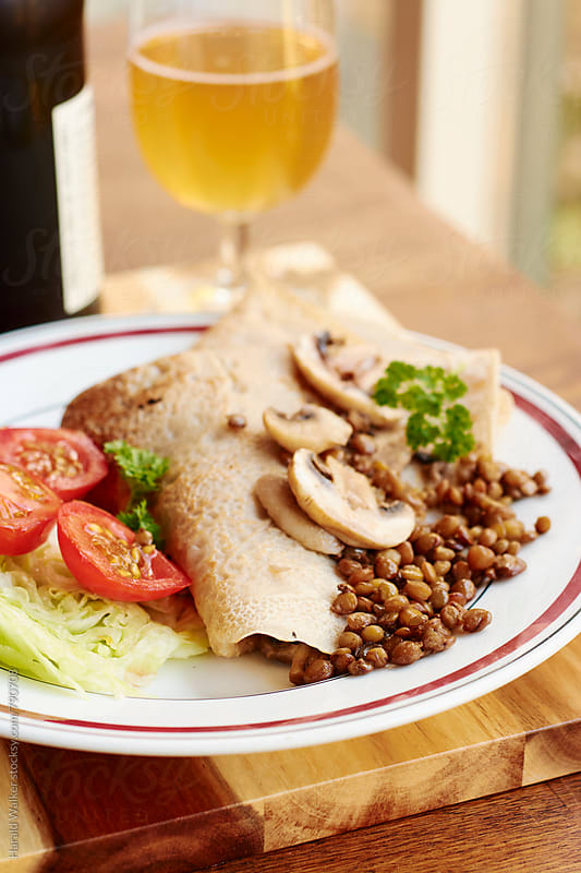 Burckwheat Crepes with Lentils and Mushrooms by Harald Walker for Stocksy United
