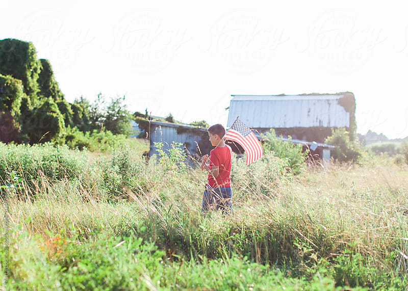 Boy with American Flag by Marta Locklear for Stocksy United