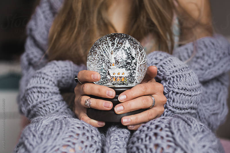 Hands holding snow ball by Irina Efremova for Stocksy United