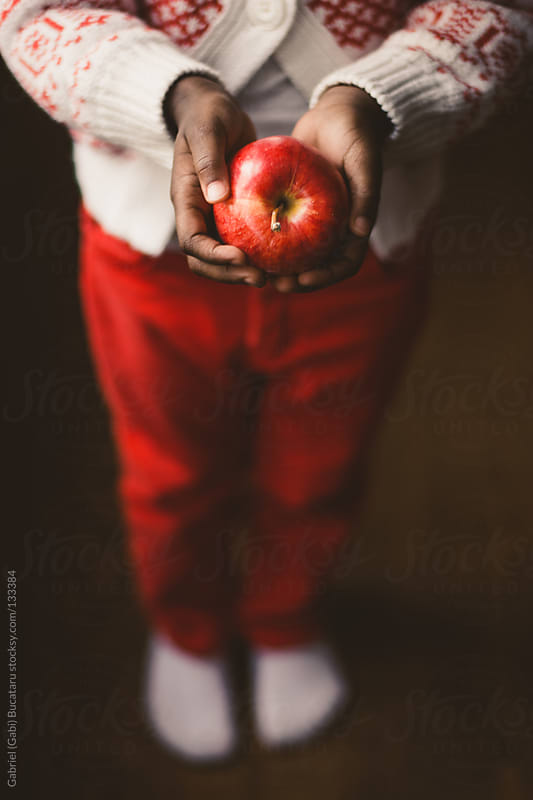 Child with Apple by Gabriel (Gabi) Bucataru for Stocksy United