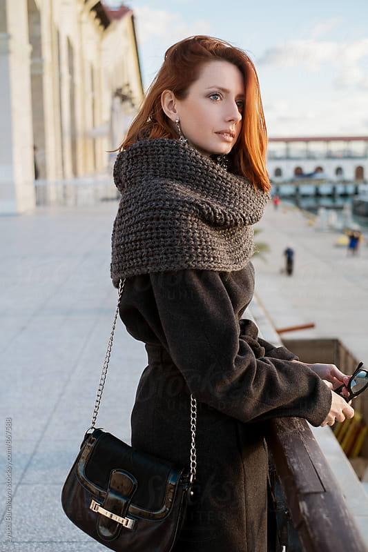 Woman standing a seaport by Lyuba Burakova for Stocksy United