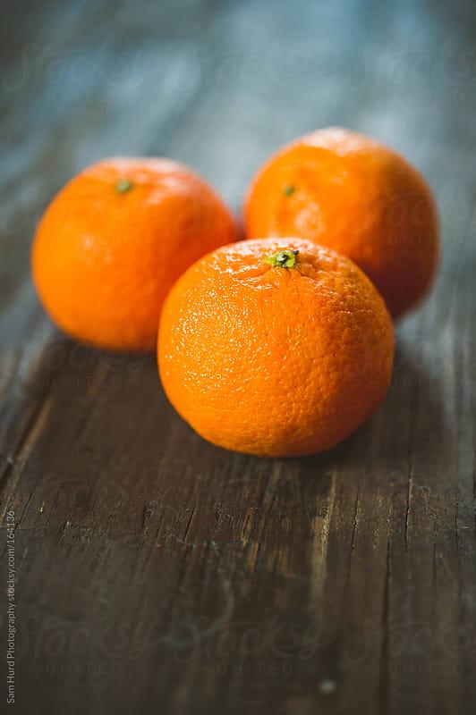 Freshly Peeled Tangerines by Sam Hurd Photography for Stocksy United