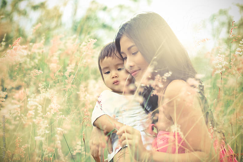 Portrait of beautiful mother and child in the nature by Nabi Tang for Stocksy United