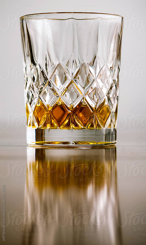 Crystal Tumbler with Whiskey by Jeff Wasserman for Stocksy United