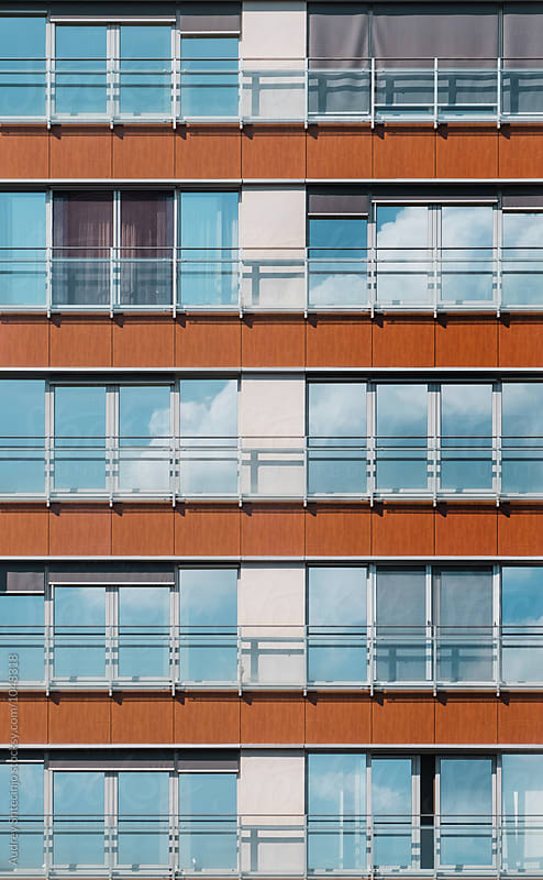 Reflection of sky in windows of building facade. by Marko Milanovic for Stocksy United