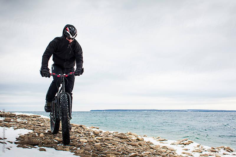 Extreme Winter Sport Man Riding Fat Bike In Snow by JP Danko for Stocksy United