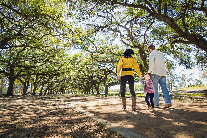 Family, walking with a little boy in the woods by yuko hirao for Stocksy United