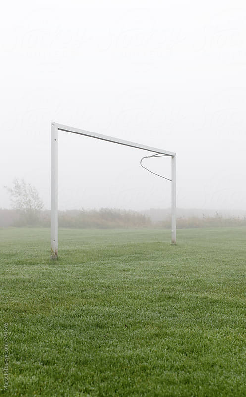Soccer goal in morning mist by Marcel for Stocksy United