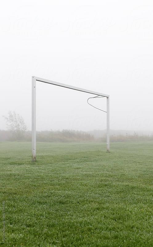 Soccer goal in morning mist by Marcel for Stocksy United