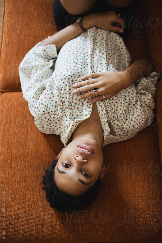 Portrait of beautiful woman lying on the couch by michela ravasio for Stocksy United