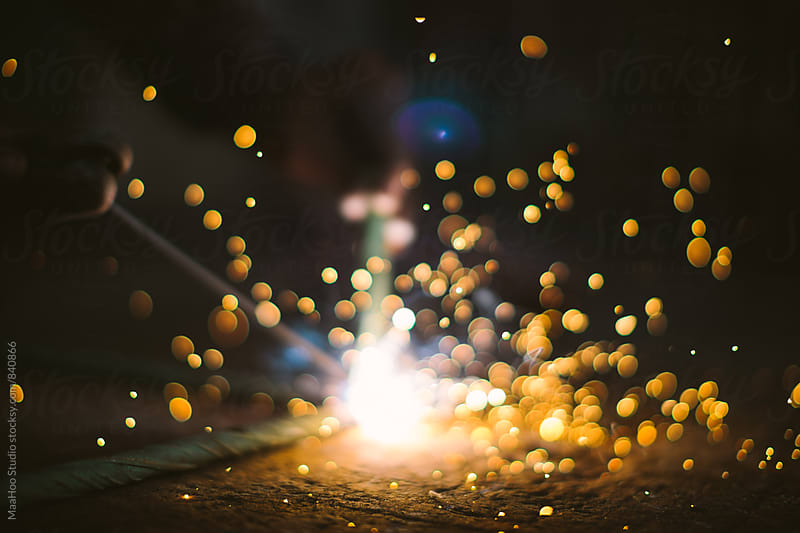Sparks during welding by MaaHoo Studio for Stocksy United