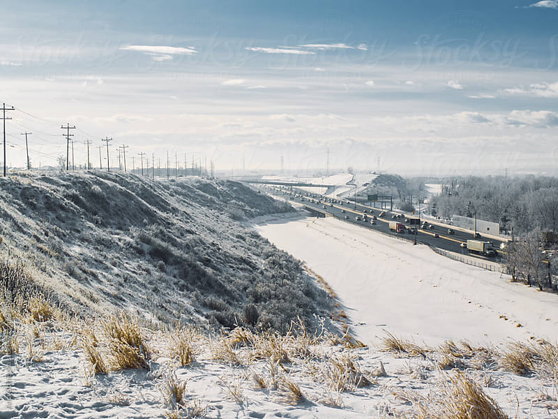 A view of a highway from a ridge on a winter day by Ania Boniecka for Stocksy United