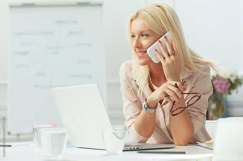 Blonde Businesswoman Making a Phone Call by Lumina for Stocksy United