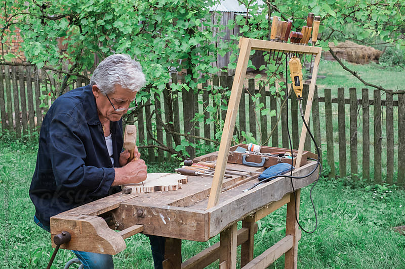 Senior Craftsman Carving Wood by Mosuno for Stocksy United