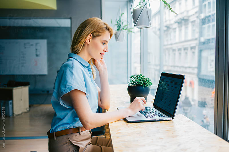 Businesswoman Working on Her Laptop by Lumina for Stocksy United