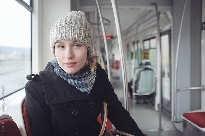 young woman in a tram by Paul Schlemmer for Stocksy United