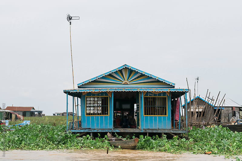 Floating Home on Tonle Sap Lake, Cambodia by Rowena Naylor for Stocksy United