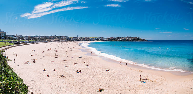 People relaxing on the Bondi beach in Sydney, Australia by Juri Pozzi for Stocksy United