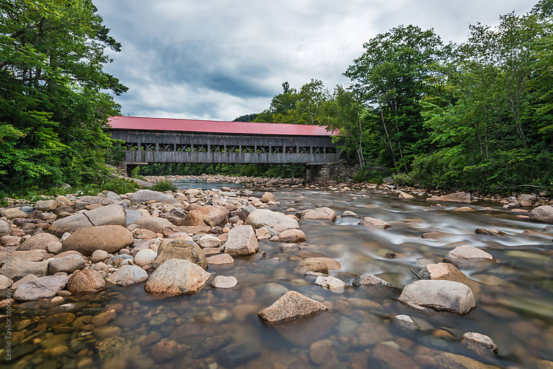 Looking Along A River At A Covered Bridge In New England by Leslie Taylor for Stocksy United