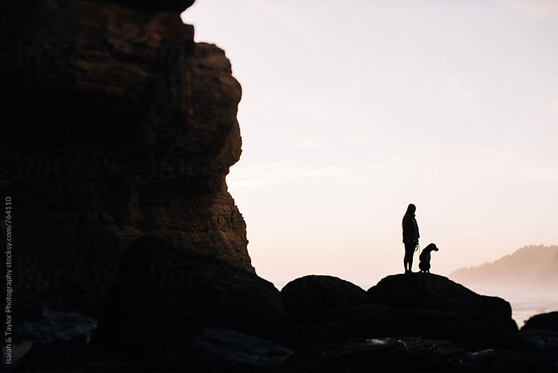 Human and dog silhouette by Isaiah & Taylor Photography for Stocksy United