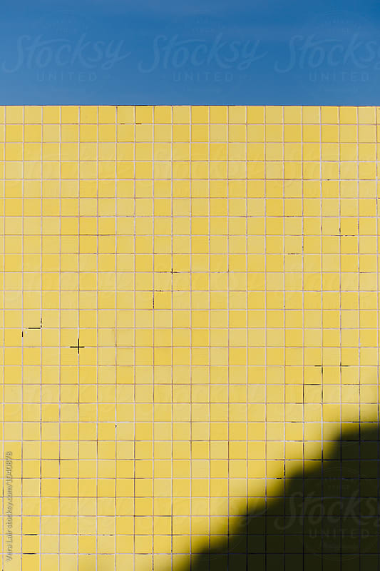 Yellow wall, blue sky by Vera Lair for Stocksy United