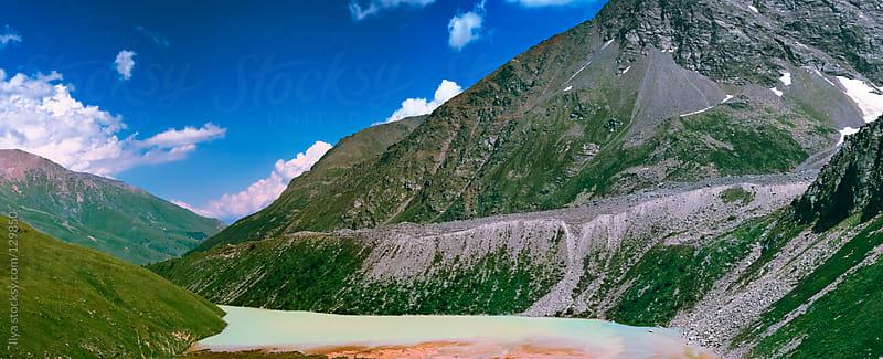Caucasus mountain lake  by Ilya for Stocksy United