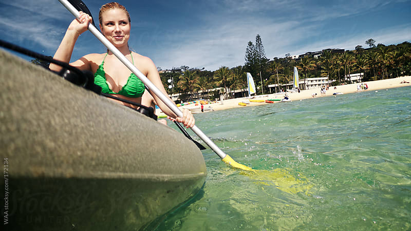 Young Woman Kayaking by WAA for Stocksy United