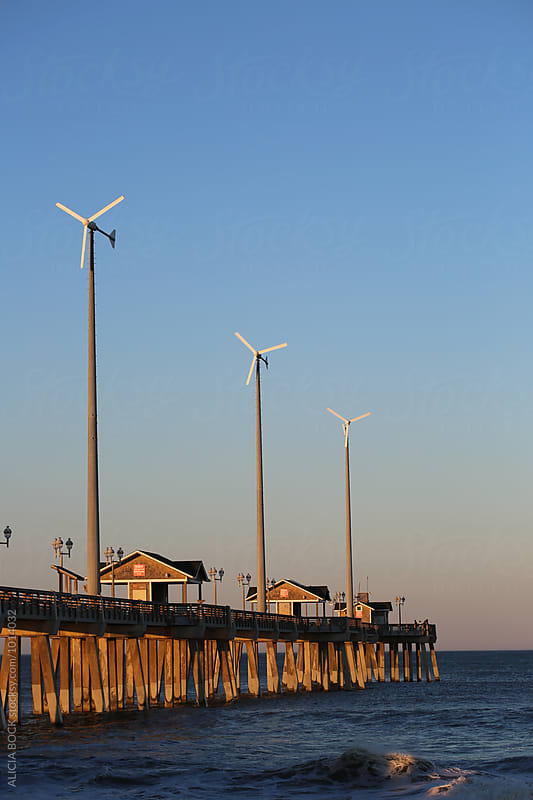 Wind Turbines On An Atlantic Ocean Pier by ALICIA BOCK for Stocksy United