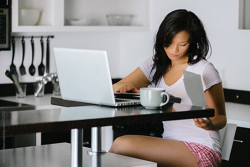 Woman working from home by Jen Grantham for Stocksy United