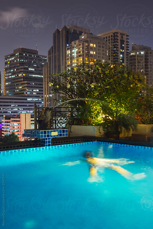 Swimming pool on Rooftop of a Skyscraper. by Mauro Grigollo for Stocksy United