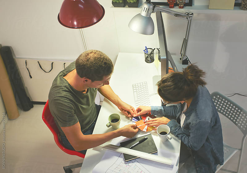 Two young architects selecting colours in the creative office. by BONNINSTUDIO for Stocksy United