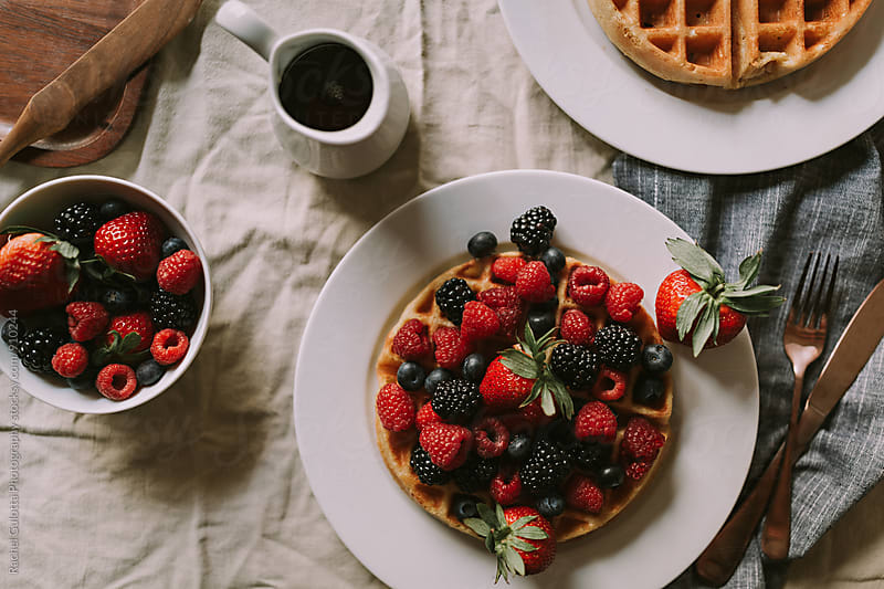 Fruit and Waffles on the Table for Breakfast or Brunch - Lifestyle Food by Rachel Gulotta Photography for Stocksy United
