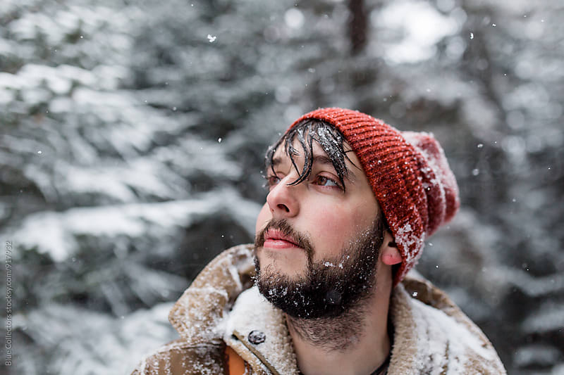 Portrait of a man outdoors. Snowing by Jordi Rulló for Stocksy United