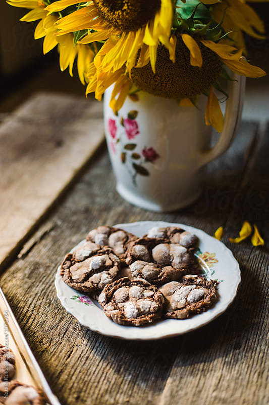 Chocolate chips cookies and sunflowers still life by Natasa Kukic for Stocksy United