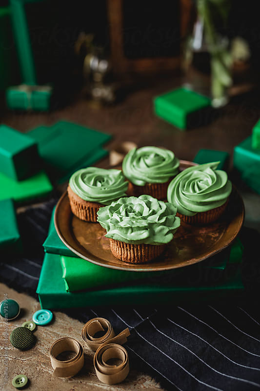 Green cupcakes for Saint Patrick's Day by Tatjana Ristanic for Stocksy United