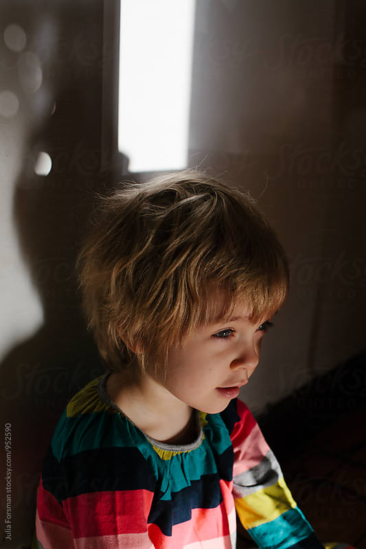 Profile of brightly dressed, relaxed child in beautiful morning light. by Julia Forsman for Stocksy United