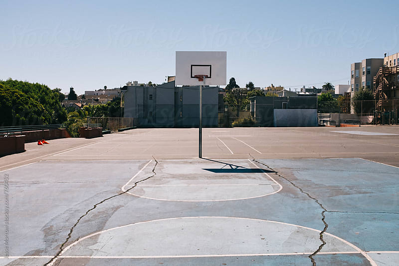 basketball court on playground in summer time by Jesse Morrow for Stocksy United