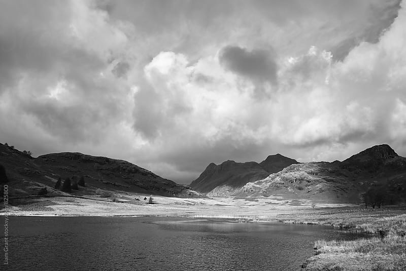 Blea Tarn with Langdale Pikes beyond. Cumbria, UK. by Liam Grant for Stocksy United