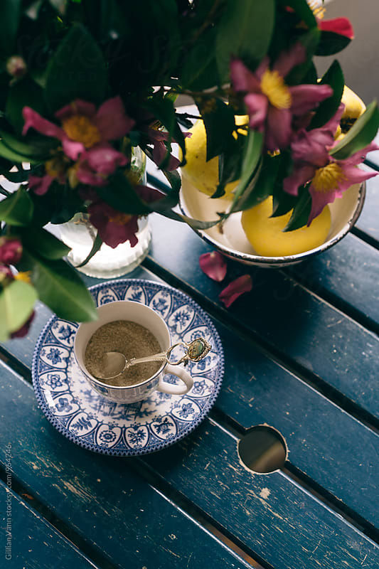 sugar in a vintage tea cup on an outdoor table by Gillian Vann for Stocksy United