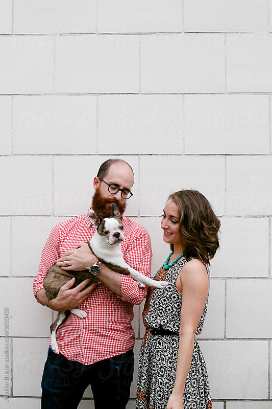 Couple with their dog  by Jen Brister for Stocksy United
