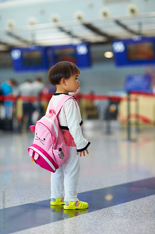 one lovely little asian girl in the airport by Bo Bo for Stocksy United