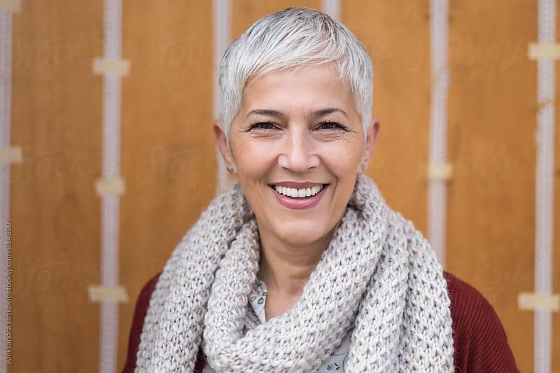Portrait of a Smiling Senior Woman by Aleksandra Jankovic for Stocksy United