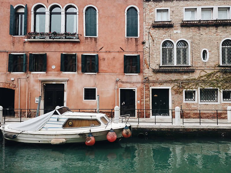 Boat on the canal of Venice by Anna Malgina for Stocksy United