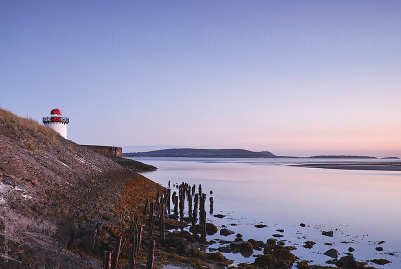 Burry Port lighthouse at twilight. Wales, UK. by Liam Grant for Stocksy United