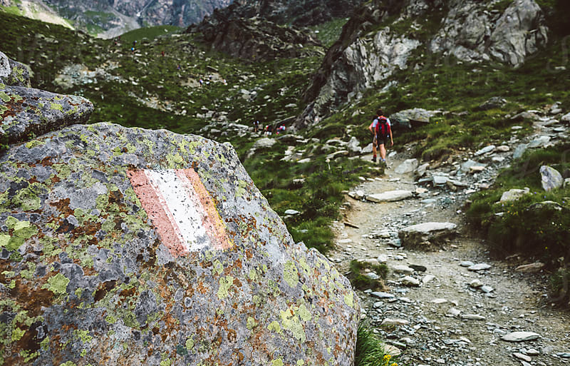 Flag sign on a path in mountain. by GIC for Stocksy United